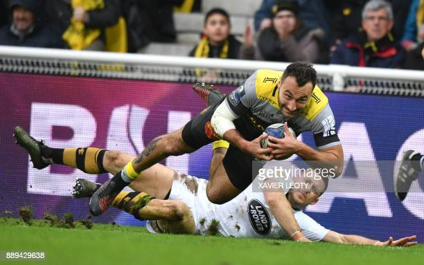 La Rochelle's French winger Jeremy Sinzelle is tackled during the European Rugby Champions Cup rugby union match between La Rochelle and Wasps at The...
