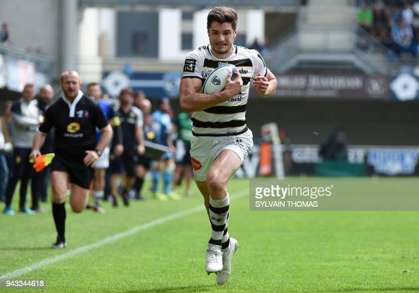 La Rochelle's French winger Pierre Boudehent runs with the ball and scores a try during the French Top 14 rugby union match between Montpellier and...