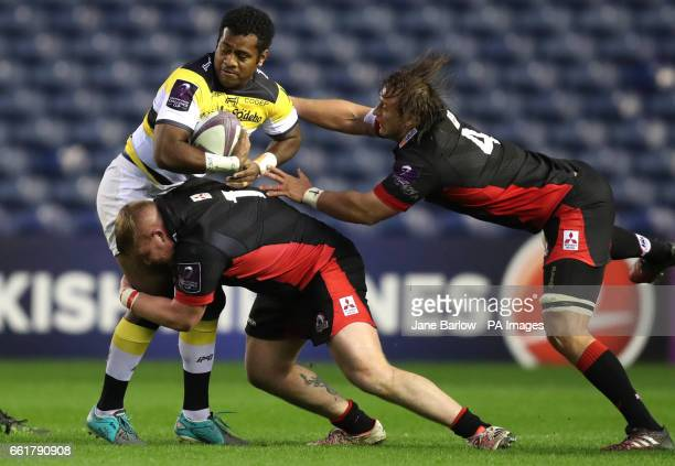 La Rochelles' Kini Murimurivalu is tackled by Edinburgh's Murray McCallum and Anton Bresler during the Challenge Cup match at BT Murrayfield Edinburgh