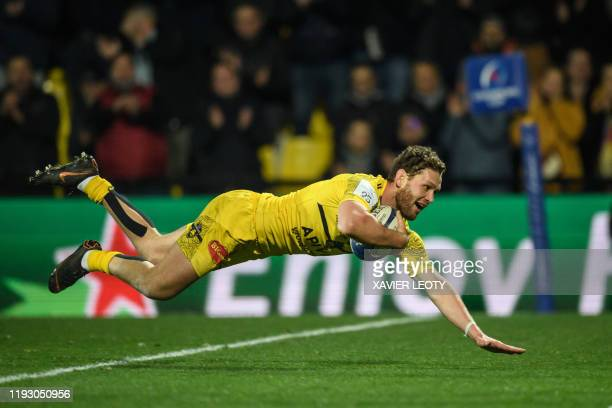 La Rochelle's New Zealand centre Tawera Kerr-Barlow scores a try during the European Rugby Champions Cup match between La Rochelle and Sale Sharks at...