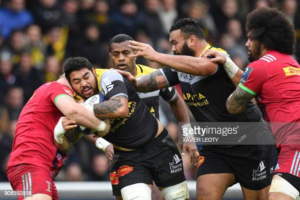 La Rochelle's New Zealand flanker Afa Amosa runs with the ball during the European Champions Cup rugby union match between La Rochelle and Harlequins...