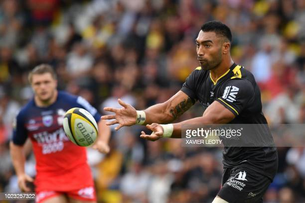 La Rochelle's New Zealand flanker Victor Vito passes the ball during the French Top 14 rugby union match between La Rochelle and Grenoble on August...