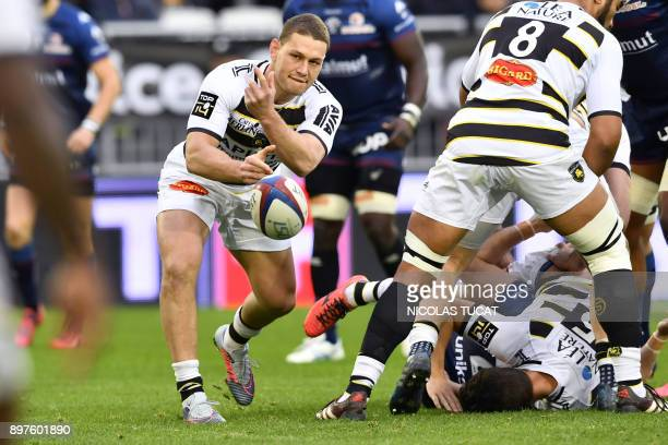 La Rochelle's New Zealander scrumhalf Tawera KerrBarlow passes the ball during the French Top 14 rugby union match between BordeauxBegles and La...