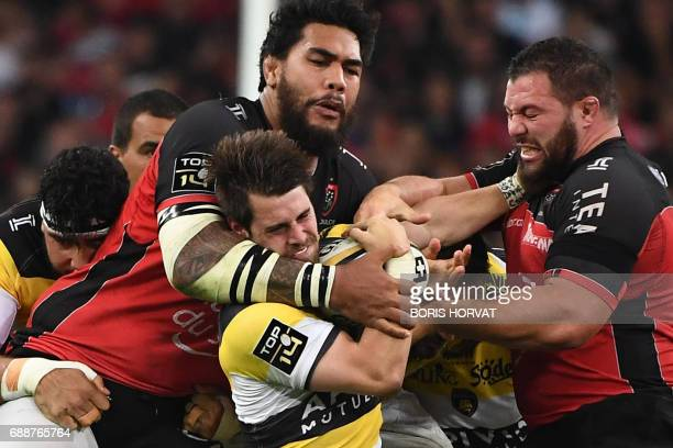 TOPSHOT La Rochelle's player Arthur Retiere vies with RC Toulon's Fijian winger Josua Tuisova and RC Toulon's French prop Florian Fresia during the...