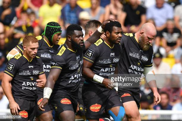 La Rochelle's players celebrate after La Rochelle's Fijian fullback Kini Murimurivalu scored a try during a French Top 14 rugby union match between...