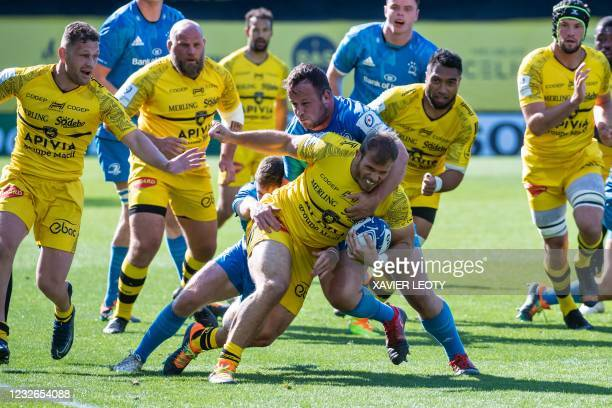 La Rochelle's South African flanker Wiaan Liebenberg is tackled during the European Champions Cup semi-final rugby union match between La Rochelle...