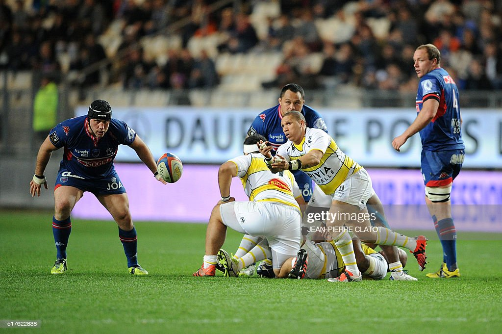 La Rochelle's South African scrumhalf Enrico Januarie clears the ball out of a ruck during the French Top 14 rugby union match Grenoble (FCG) vs La Rochelle (ASR) on March 26, 2016 at the Stade des Alpes in Grenoble.