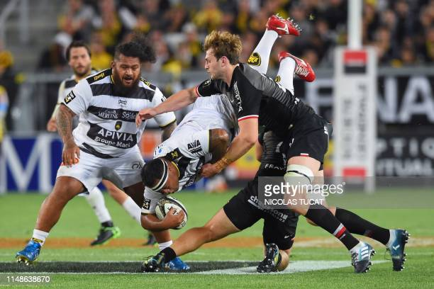 La Rochelle's Tongan prop Sila Puafisi is tackled during the French Top 14 semi-final rugby union match between Toulouse and La Rochelle on June 8,...