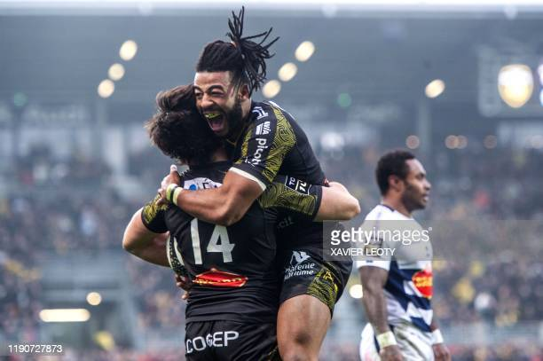 La Rochelle's Valentin Tirefort and Jules Favre celebrates during the French Top 14 rugby union match between La Rochelle and Castres at the Marcel...