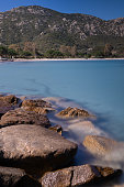 rocks sand beautiful blue water