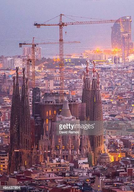 'La Sagrada Familia' stands over residential buildings on October 26 2015 in Barcelona Spain 'La Sagrada Familia' Foundation announced on October 21...