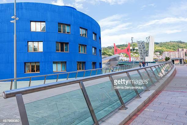 la salve bridge and facade of guggenheim museum bilbao, spain. - daniel buren stockfoto's en -beelden