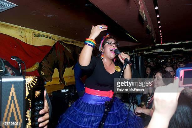 La Santa Cecilia performs on stage at their album release party at La Cita Bar on March 4 2014 in Los Angeles California