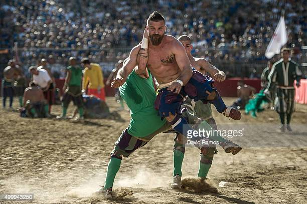 La Santa Croce Azzurri Team player Alessio Giorgerini duels for the ball during the semifinal match against the San Giovanni Verdi Team on June 16...