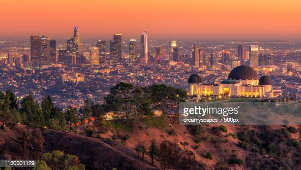 la skyline at sunset - griffith park stock pictures, royalty-free photos & images