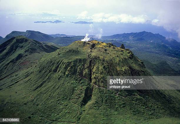 La Soufriere volcano emitting steam in Guadeloupe with a view of Les Saintes in the background | Location La Soufriere Guadeloupe France