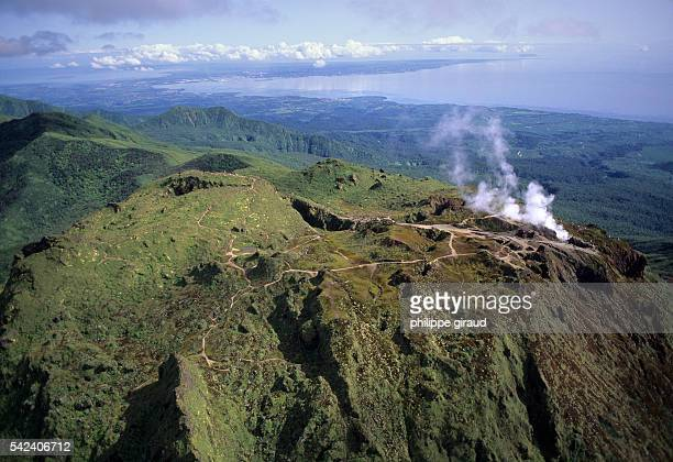 La Soufriere volcano emitting steam in Guadeloupe with views towards La Basse Terre and La Grande Terre in the background.   Location: La Soufriere,...