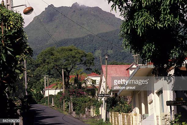 La Soufriere volcano emitting steam viewed from the village of Saint Claude.   Location: La Soufriere, Guadeloupe, France.
