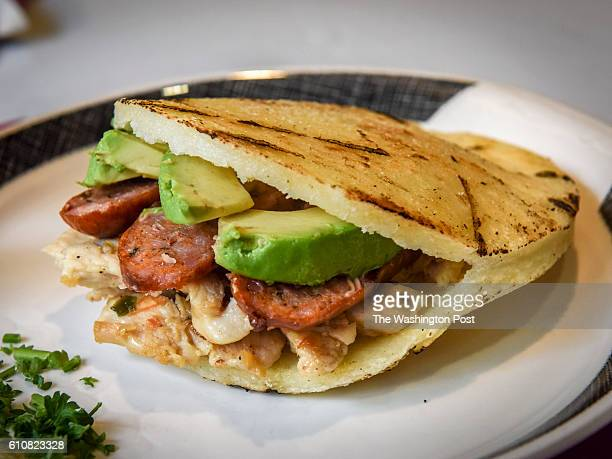 La Surena arepa a corn cake with grilled chicken chorizo and avocado at Arepas Pues which combines Colombia Cuban and Venezuelan dishes for the $20...