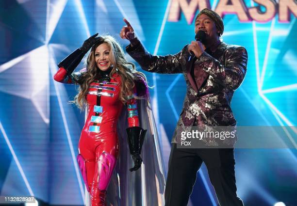 La Toya Jackson and host Nick Cannon in the All Together Now episode of THE MASKED SINGER airing Wednesday Feb 13 on FOX