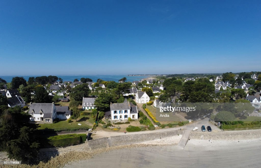 La Trinite-sur-Mer (Brittany, north-western France) close to the Gulf of Morbihan, on : aerial view of the 'Pointe de Kerbihan' headland from the beach 'plage de Kerbihan', coastal path.