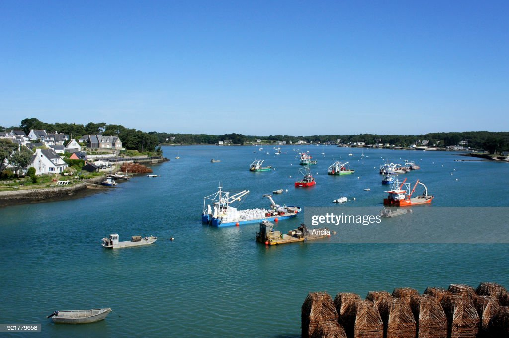 La Trinite-sur-Mer (Brittany, north-western France), June 2015: oyster barges and fishing boats lying at anchor viewed from the Kerisper Bridge.