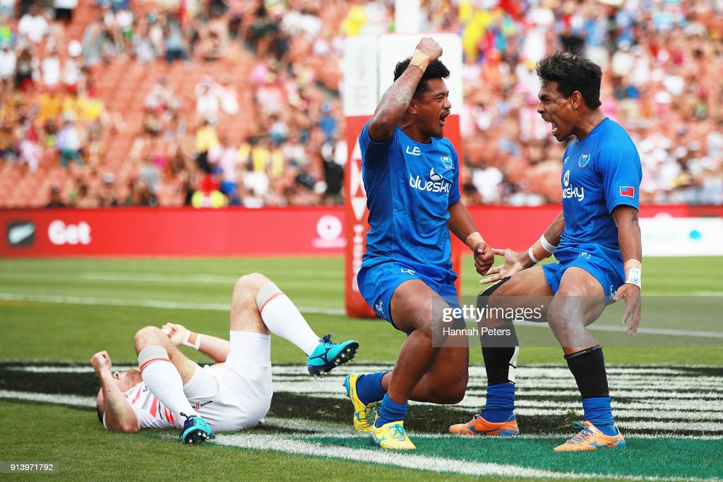 Laaloi Leilua of Samoa celebrates with Murphy Paulo after scoring the winning try against England during the 2018 New Zealand Sevens at FMG Stadium on February 4, 2018 in Hamilton, New Zealand.