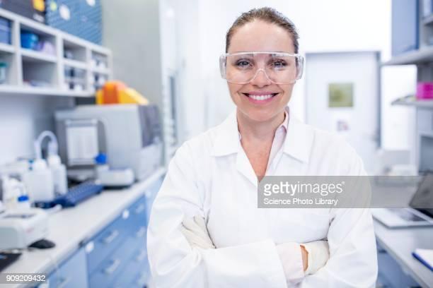 lab assistant wearing safety goggles - schutzbrille stock-fotos und bilder