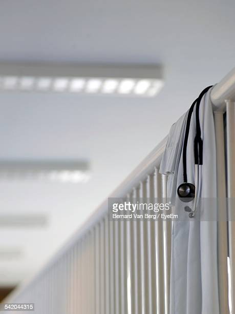 lab coat and stethoscope on railing in hospital - quitting a job stock pictures, royalty-free photos & images