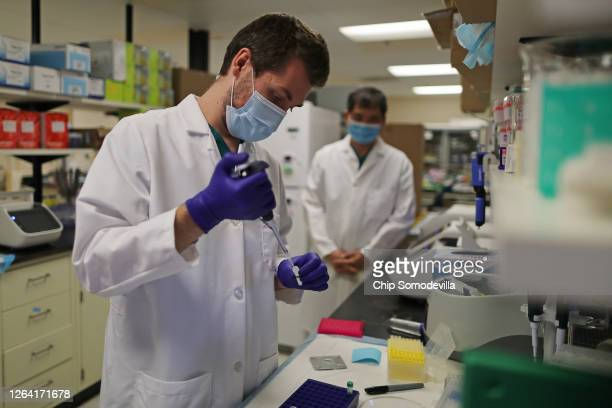 Lab Technician Carter Tavaglione prepares a solution that will be used to process coronavirus test samples at Advagenix a molecular diagnostics...