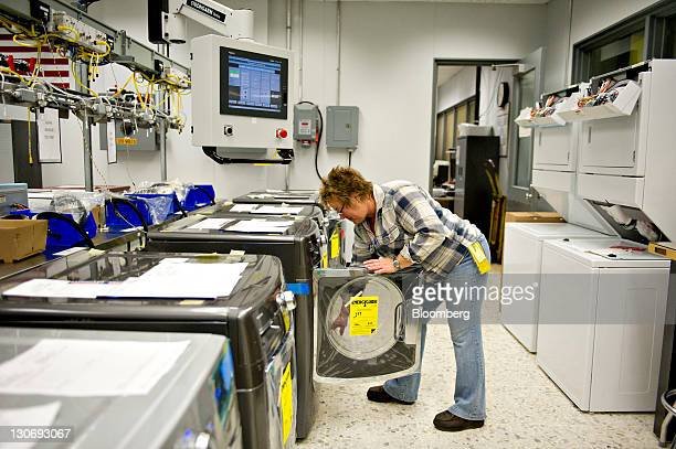 Lab technician Diane Valentine prepares a Maytag Corp Maxima washing machine for testing at the Whirlpool Corp operations plant in Clyde Ohio US on...