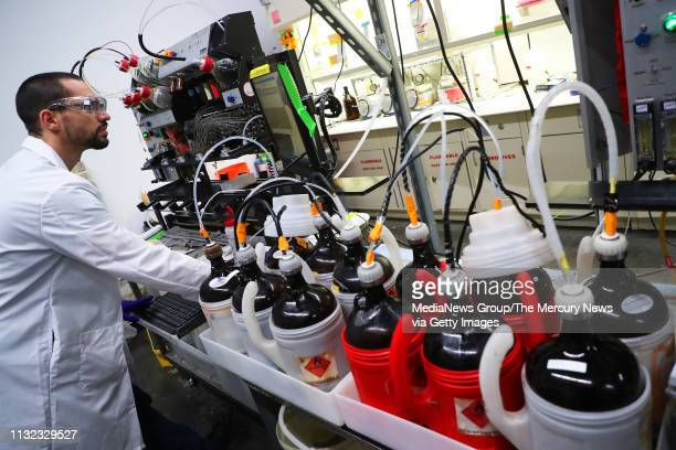 ATUM lab technician Gabe Setti works with a DNA synthesizer on Wednesday Feb 20 in Newark Calif ATUM is a leader in a consortium of synthetic bio...