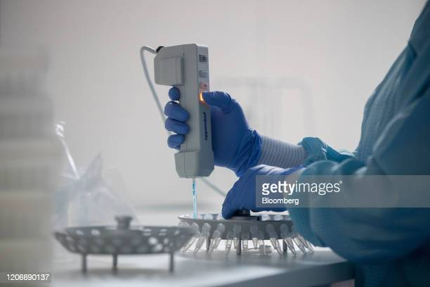 A lab technician prepares solutions for the manufacture of coronavirus diagnostic test kits in a clean room at the TIB Molbiol Syntheselabor GmbH...
