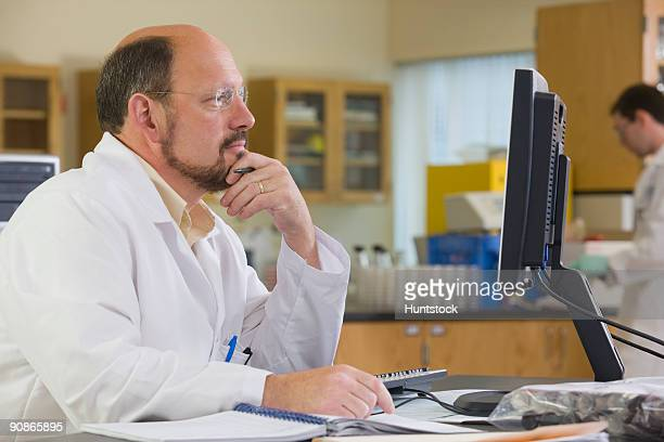 Lab technician working on a computer