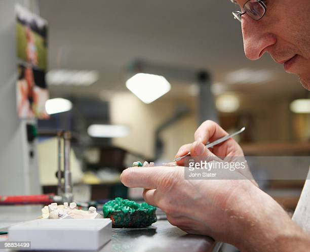 lab technician working on dental casting