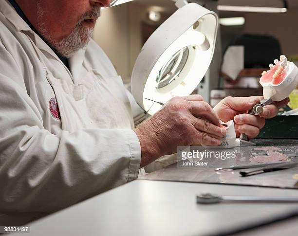 lab technician working on dental impression - health2010 ストックフォトと画像