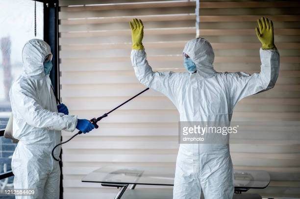 lab technicians in the quarantine clothes - serbia stock pictures, royalty-free photos & images