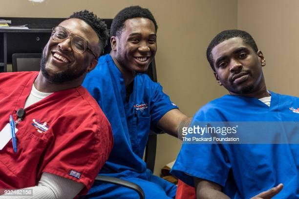 Lab technicians Raphael Anderson Bruce Shelby and Aubrey Humphrey pose for a portrait at Open Arms Healthcare Center Open Arms addresses the alarming...