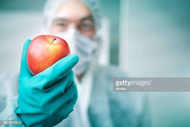 Lab Worker Holding Apple