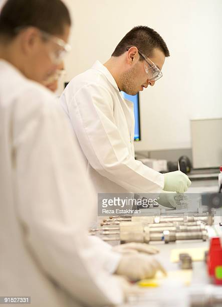 lab workers - newhealth stock photos and pictures