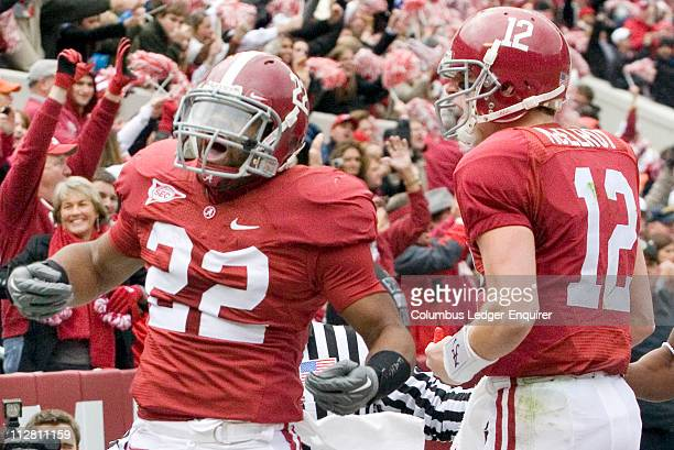 labama running back Mark Ingram left and quarterback Greg McElroy celebrate a touchdown on the opening drive against Auburn at BryantDenny Stadium in...