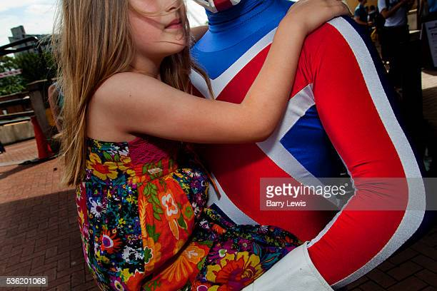 Laban with daughter Madison as Captain Britain from the charity Heroes Alliance attending the London Film and Comic Con LFCC is a convention held...