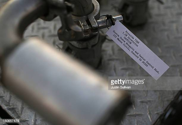 A label for Pyrocide 7396 insecticide is affixed to a spray nozzle on the back of a Contra Costa County Mosquito and Vector Control District truck on...