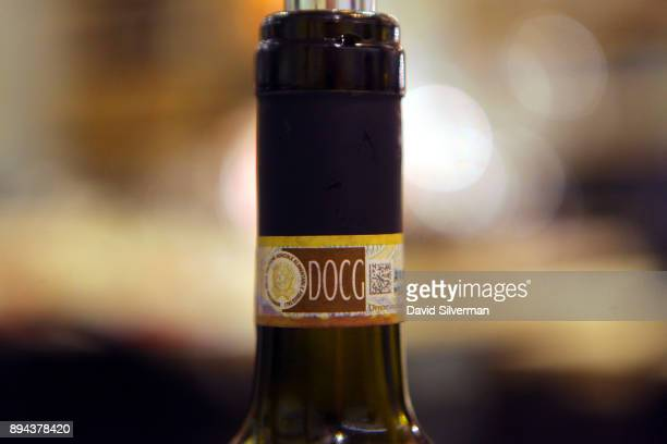 DOCG label is seen on the neck of a bottle of red Italian wine at the Rimessa Roscioli restaurant on December 8 2017 in Rome Italy The letters DOCG...
