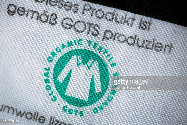Label of a tshirt with the GOTS logo the Global Organic Textile Standard on February 26 2015 in Berlin Germany Global Organic Textile Standard is the...