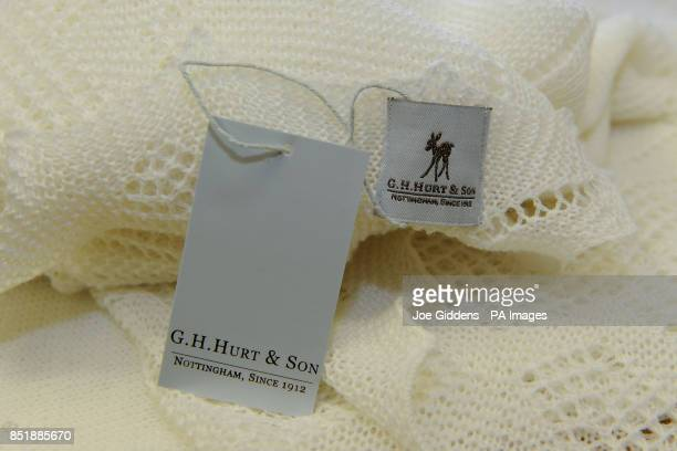 A label on a superfine merino wool christening shawl as worn by Prince George of Cambridge outside St Mary's Hospital which GH Hurt Son based in...