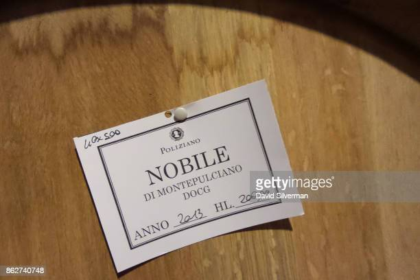 A label pinned to a 500 liter oak barrel in Poliziano winery's cellars notes that 400 barrels of 500 liters each hold altogether 20000 liters of...