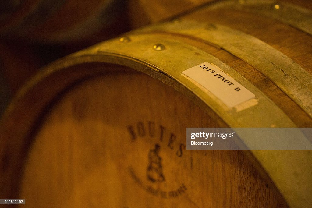A label reading '2015 Pinot B' marks a barrel of maturing wine in a temperature-controlled building inside the Weingut Friedrich Becker Estate in Schweigen, Germany, on Tuesday, Oct. 4, 2016. Global warming has been good to German viticulture, with average temperatures up 1.4 degrees centigrade over the past 40 years, creating the perfect climate for notoriously finicky pinot noir vines. Photographer: Krisztian Bocsi/Bloomberg via Getty Images