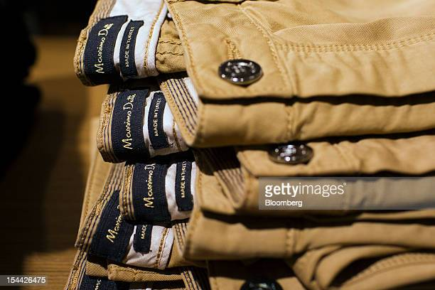 Labels are seen on trousers displayed for sale inside a Massimo Dutti store a division of Inditex SA in Madrid Spain on Friday Oct 19 2012 To...