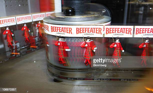 Labels for Beefeater gin move round a spool at the Pernod Ricard SA bottling plant in Dumbarton UK on Friday Nov 19 2010 Pernod Ricard SA the world's...